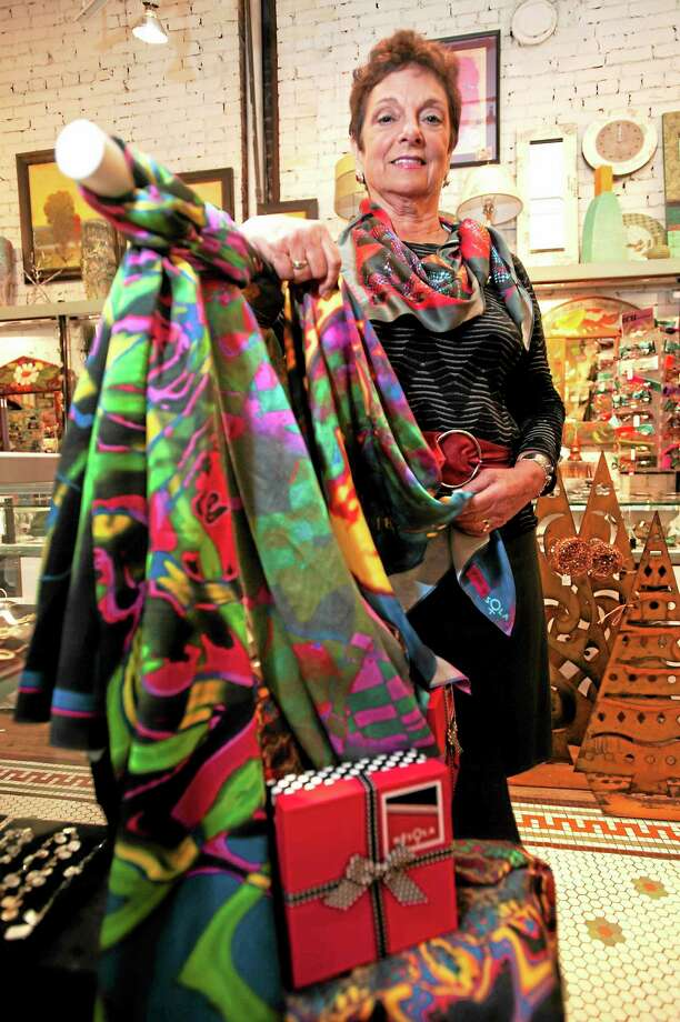 Artist Lois Goglia of Cheshire says she finds inspiration for her work in the vibrant people and culture of San Miguel de Allende, Mexico. Photo: VmWilliams — New Haven Register Photo