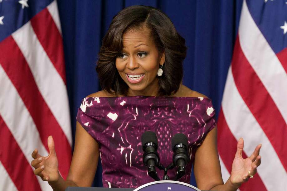 "FILE - In this July 10, 2013, file photo, first lady Michelle Obama speaks to mayors and other officials about the initiative, ""Let's Move! Cities, Towns and Counties,"" in the Eisenhower Executive Office Building on the White House complex in Washington. The first lady, an exercise fanatic who loves French fries and whose biceps are envied by women everywhere, is getting behind a campaign being launched Thursday to encourage people to drink more plain, old-fashioned water. Whether it comes from a faucet, an underground spring, a rambling river or a plastic bottle, the message is ""drink up."" (AP Photo/Jacquelyn Martin, File) Photo: AP / AP"