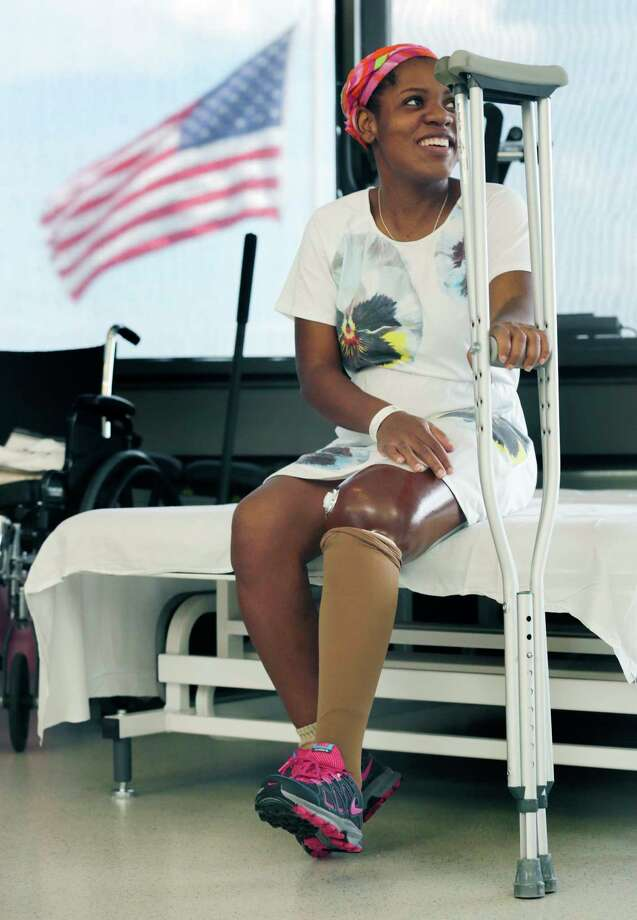 FILE-- This July 3, 2013 file photograph shows Boston Marathon bombing survivor Mery Daniel smiling during a break in her physical therapy session at Spaulding Rehabilitation Hospital, in Boston.  Some Boston Marathon bombing amputees, including Daniel, will be meeting with wounded military veterans as part of a nonprofit's efforts to raise money for both groups. (AP Photo/Charles Krupa) Photo: AP / AP