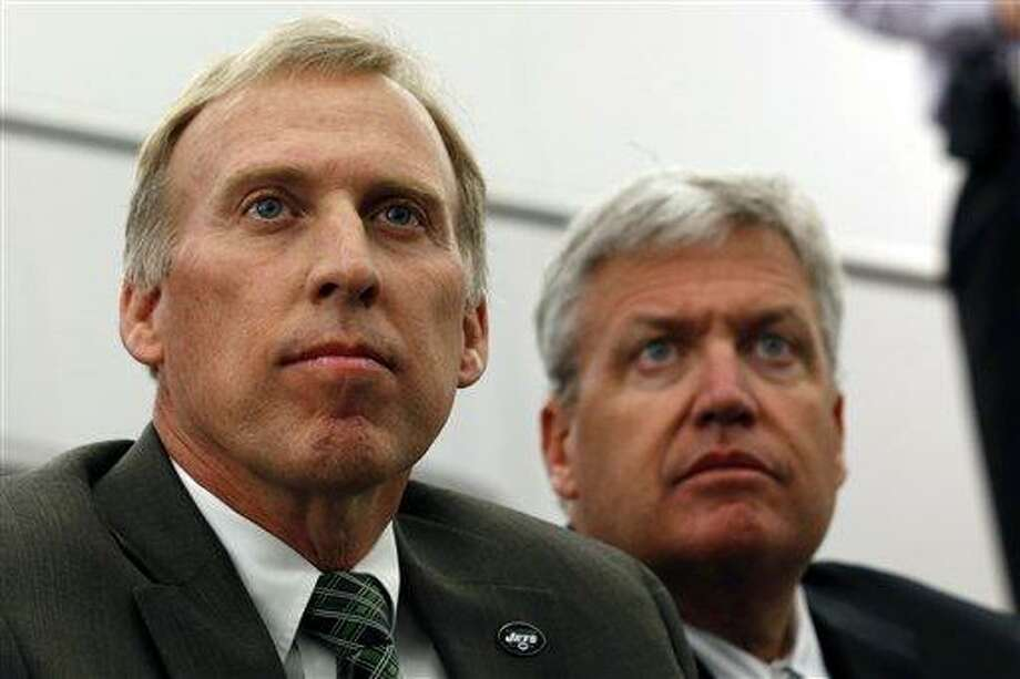 John Idzik, left, sits next to New York Jets head coach Rex Ryan while waiting to be introduced as the Jets new general manager during an NFL football news conference, Thursday, Jan. 24, 2013, in Florham Park , N.J. (AP Photo/Julio Cortez) Photo: ASSOCIATED PRESS / AP2013