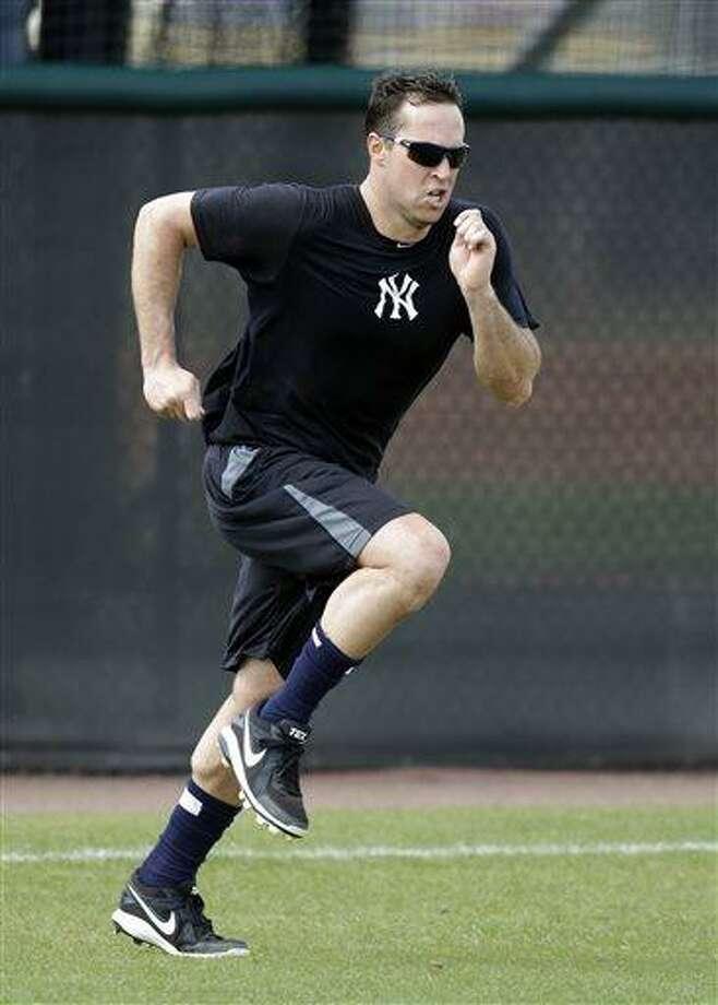 New York Yankees first baseman Mark Teixeira runs sprints during a rehab workout at the Yankees' Minor League complex Monday, May 6, 2013, in Tampa, Fla. Teixeira is making progress towards his return from a wrist injury. (AP Photo/Chris O'Meara) Photo: AP / AP
