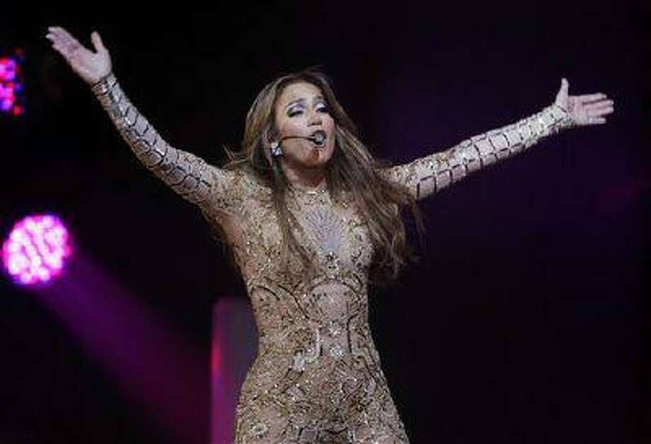 "In a March 23, 2013, file photo Jennifer Lopez performs at the JW Marriott Desert Ridge Resort and Spa in Phoenix. Jennifer Lopez sang ""Happy Birthday"" to the leader of Turkmenistan during a performance DSaturday June 29, 2013, but her representative says had she known there were human rights issues in the country, she wouldn't have performed there at all.(Photo by Rick Scuteri/Invision/AP, file) Photo: Rick Scuteri/Invision/AP / AP2013"