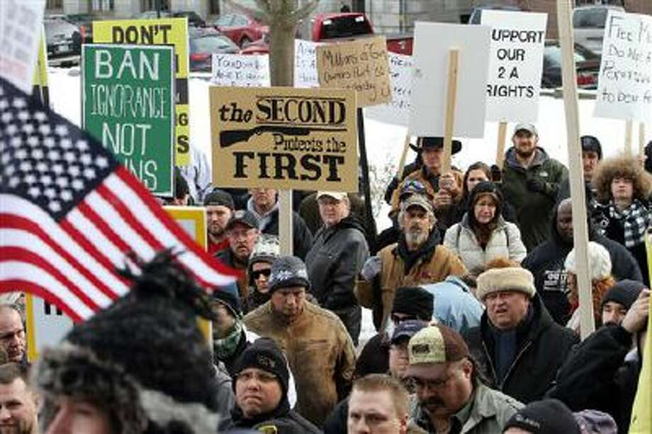 Hundreds of gun supporters rally earlier this year at the Statehouse in Concord, N.H. Photo: AP / AP