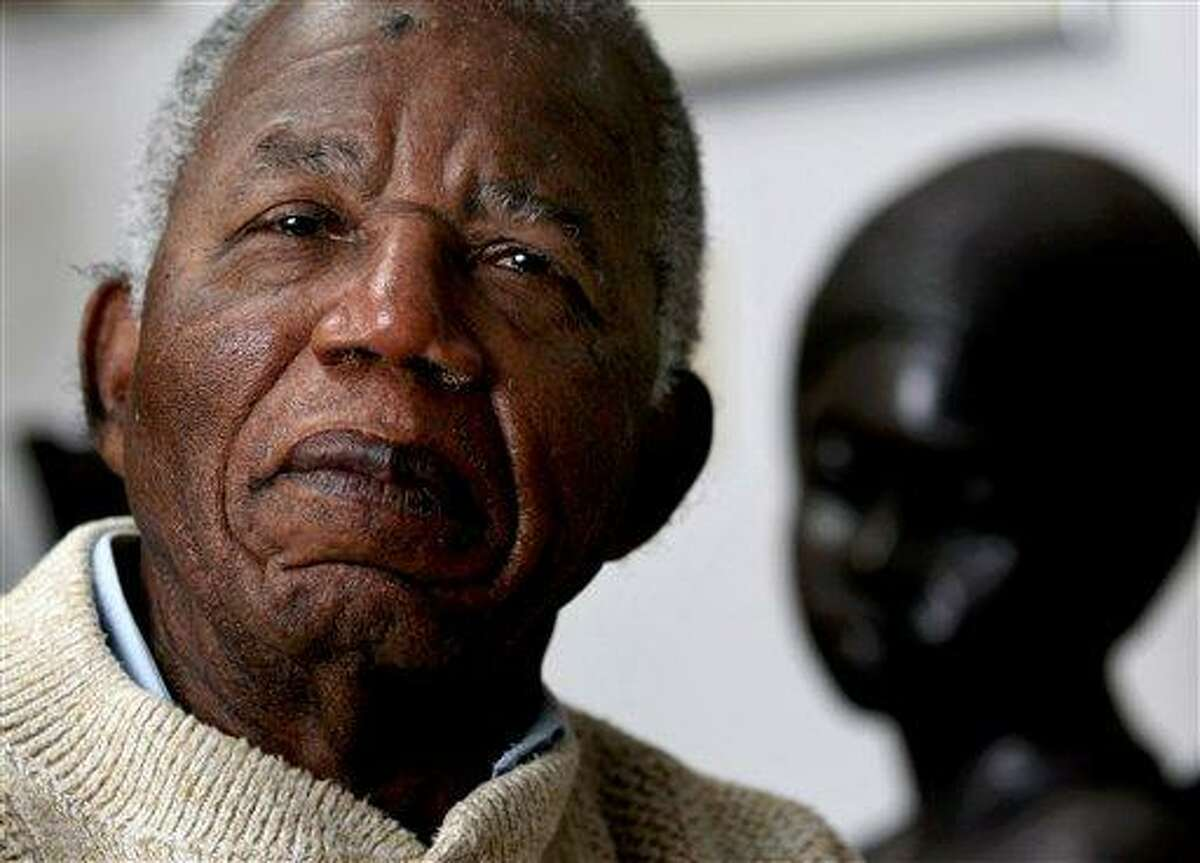 """In this 2008 file photo, Chinua Achebe, Nigerian-born novelist and poet, poses at his home on the campus of Bard College in Annandale-on-Hudson, New York, where he was a professor. Achebe wrote the classic """"Things Fall Apart,"""" one of the six books former President Barack Obama recommended on his Facebook page on Friday, July 13."""