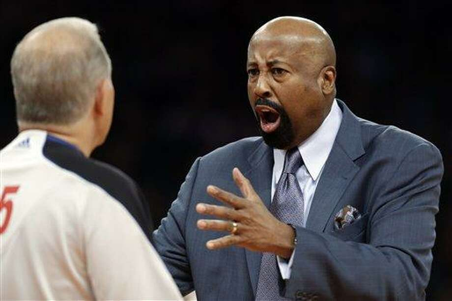 New York Knicks head coach Mike Woodson complains to referee Bennett Salvatore, left, in the first half of their NBA basketball game against the Brooklyn Nets at Madison Square Garden in New York, Monday, Jan. 21, 2013. The Nets won 88-85. (AP Photo/Kathy Willens) Photo: AP / AP