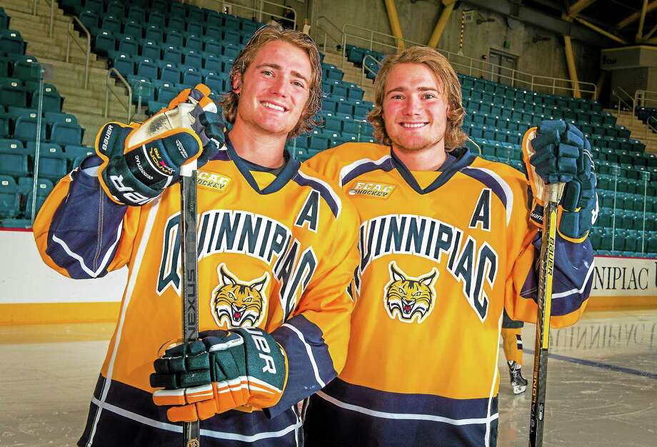 Quinnipiac senior Kellen Jones, left, is about to join twin brother Connor in the Bobcats' 100-point club. Photo: Submitted Photo   / Copyright John Hassett 2013. All rights reserved