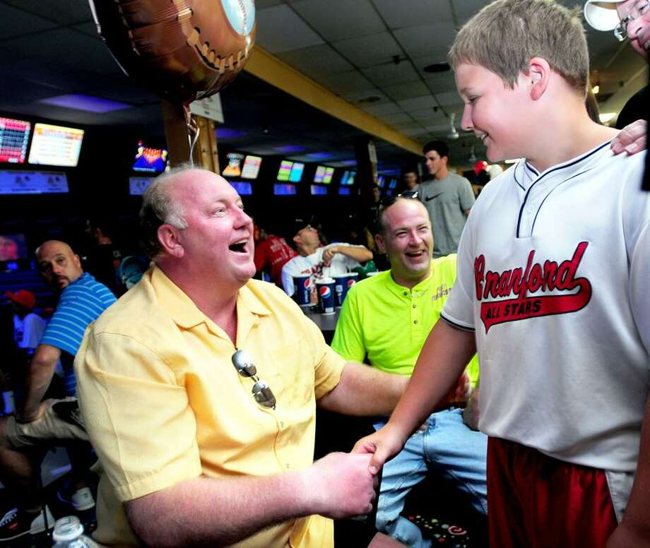 George Dummar, left, shares a laugh with Eddie Zanor 11, of Branford at a bowling fundraiser at AMF Circle Lanes in East Haven for the Dummar family in August. Dummar is battling brain cancer. (Arnold Gold/Register)