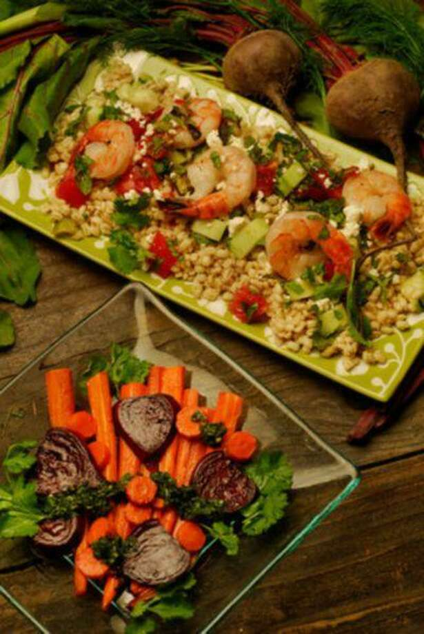 Grilled Shrimp and Scallions on Barley with Cucumbers, Tomatoes and Feta, top, and Roasted Beet and Carrot Salad with Basil-Cilantro Puree, photographed in Walnut Creek, Calif., on Wednesday, July 10, 2013. (Mark DuFrene/Bay Area News Group) Photo: Bay Area News Group / Bay Area News Group