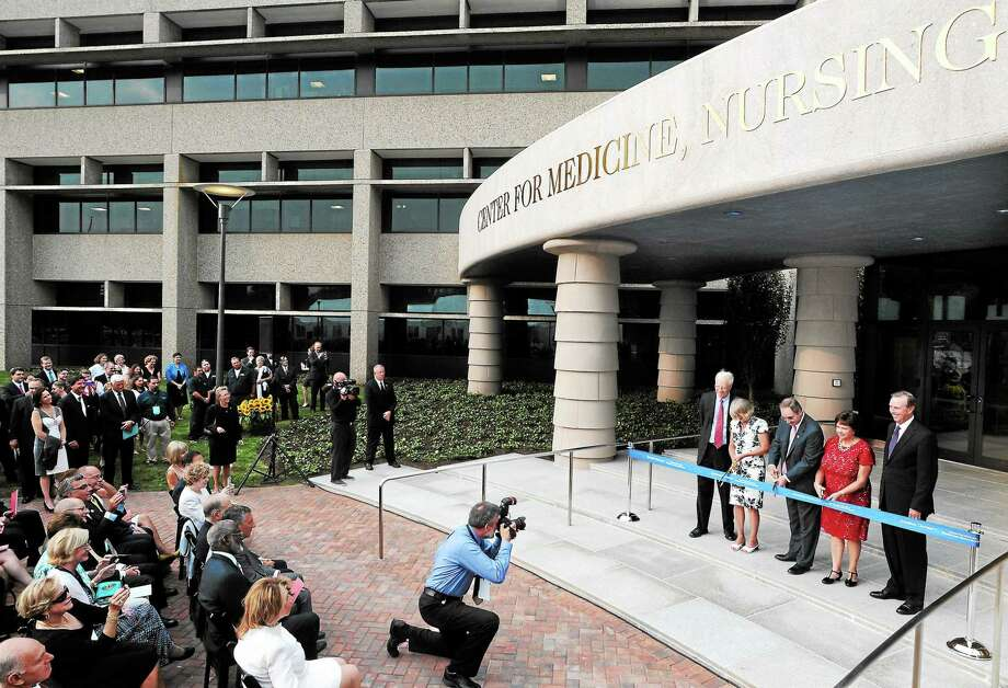 (Mara Lavitt — New Haven Register) September 12, 2013 North Haven.Quinnipiac University ribbon cutting for the Center for Medicine, Nursing and Health Sciences, as well as the dedication of the Frank H. Netter MD School of Medicine, on the former Anthem campus, North Haven. QU president John Lahey is at right. Photo: Journal Register Co. / Mara Lavitt