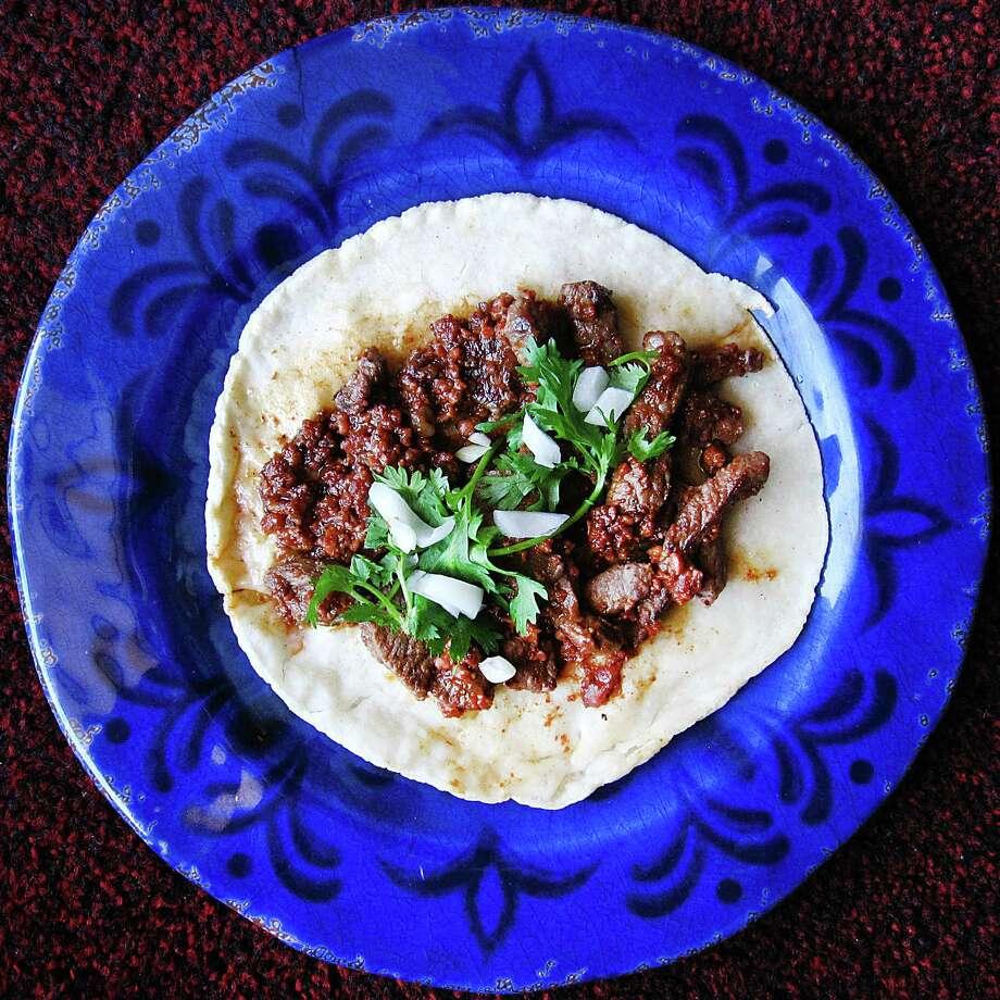 Camilong taco with carne asada, chorizo, cilantro and onions on a handmade corn tortilla from Jenny's Mexican Restaurant. Photo: Mike Sutter, San Antonio Express-News