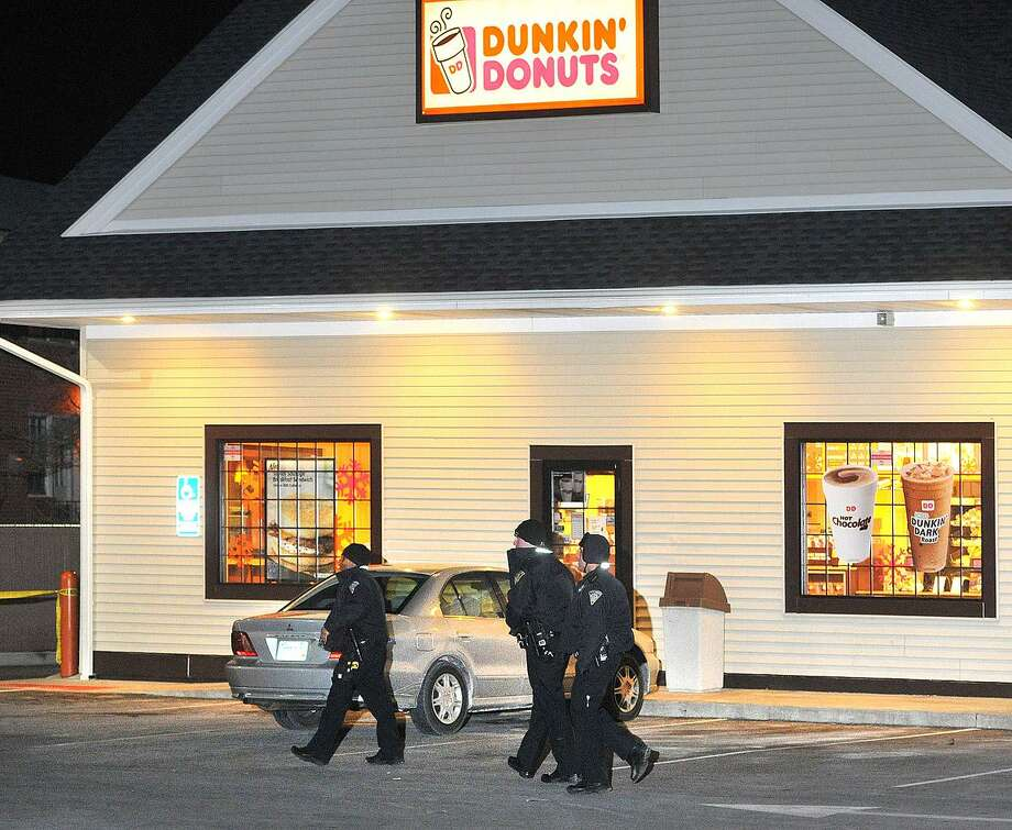 New Haven-- New Haven Police investigate the scene of a shooting at the Dunkin Donuts at the corner of Blake and Fitch Streets in the early evening Weds.(Around 7:15pm)  Photo-Peter Casolino 1/23/13