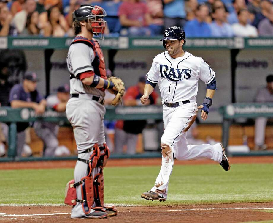 The Rays' David DeJesus, right, scores in the third inning of Thursday's game. Photo: Chris O'Meara — The Associated Press   / AP