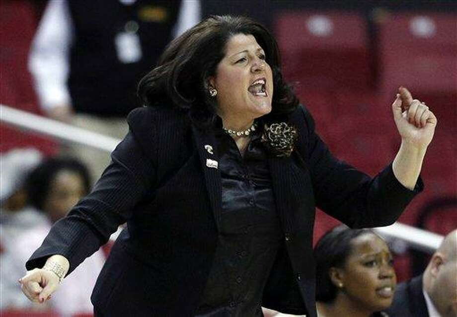 Quinnipiac head coach Tricia Fabbri directs her players during the first half of a first-round game against Maryland in the women's NCAA college basketball tournament in College Park, Md., Saturday, March 23, 2013. Maryland won 72-52. (AP Photo/Patrick Semansky) Photo: AP / AP
