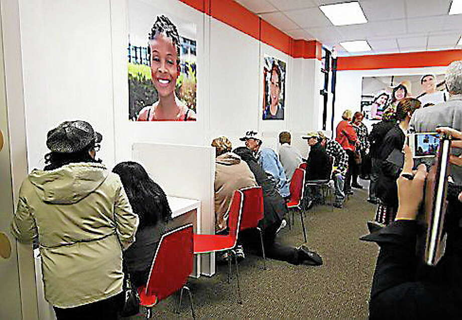 Individuals enroll in health insurance plans at the Access Health CT store in New Britain. Photo: Journal Register Co.