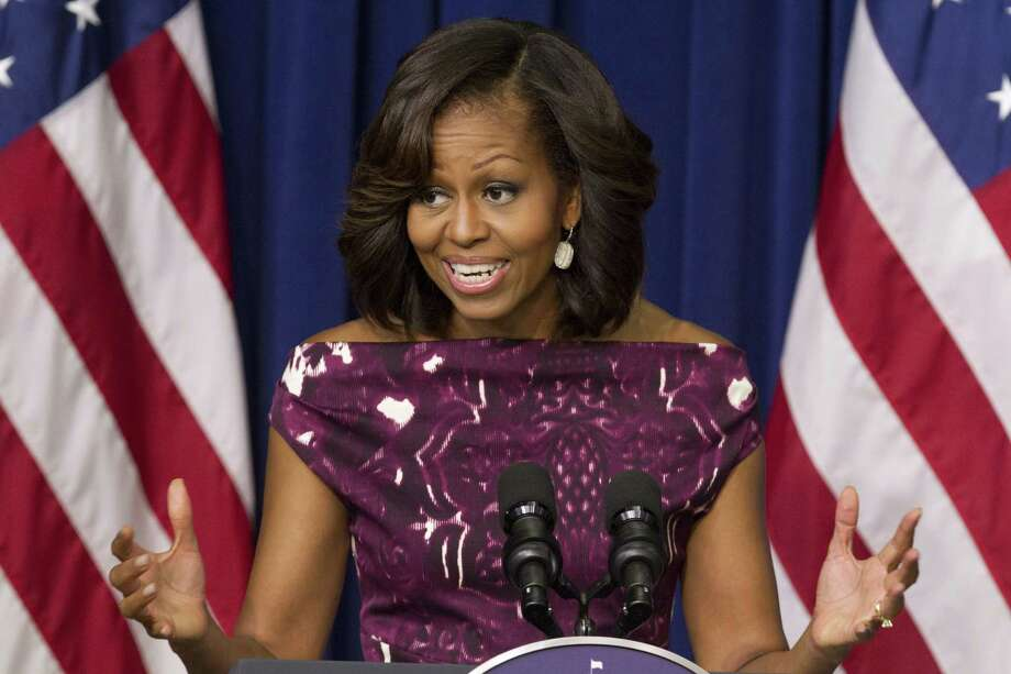 """In this July 10, 2013 photo, first lady Michelle Obama speaks to mayors and other officials about the initiative, """"Let's Move! Cities, Towns and Counties,"""" in the Eisenhower Executive Office Building on the White House complex in Washington. The first lady Thursday to encouraged people to drink more plain, old-fashioned water. Photo: AP Photo/File / AP"""