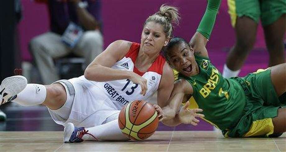 Great Britain's Johannah Leedham (13) and Brazil's Joice Rodrigues (7) dive for a loose ball during a preliminary women's basketball game at the 2012 Summer Olympics, Sunday, Aug. 5, 2012, in London. (AP Photo/Eric Gay) Photo: ASSOCIATED PRESS / AP2012