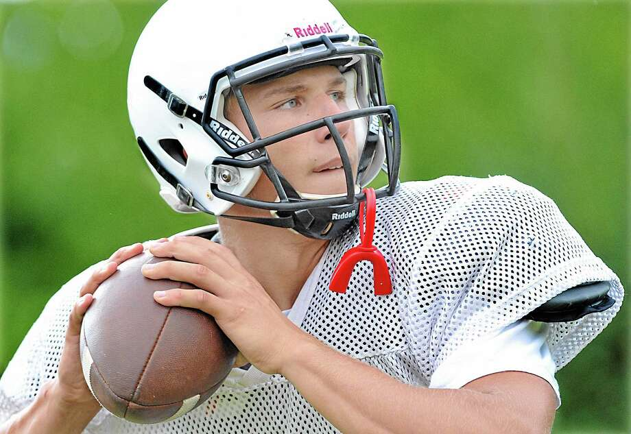 Xavier senior captain quarterback Joe Carbone works on a passing drill at practice Thursday afternoon. Catherine Avalone - The Middletown Press Photo: Journal Register Co. / TheMiddletownPress