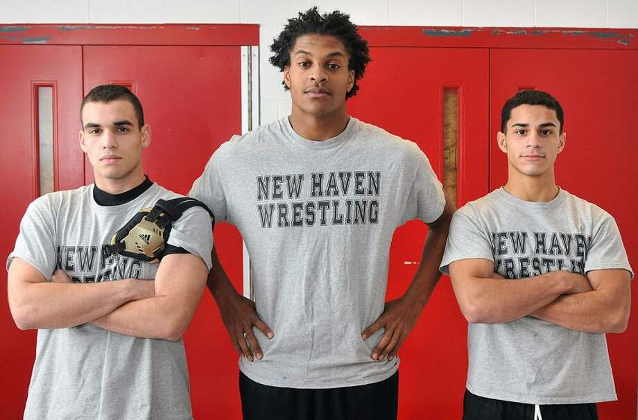 The New Haven wrestling team has already doubled its win total from last season thanks to the leadership and performance of tri-captains, from left, Jonathan Ortiz, Daykwion Aleman and Kenny Agosto.