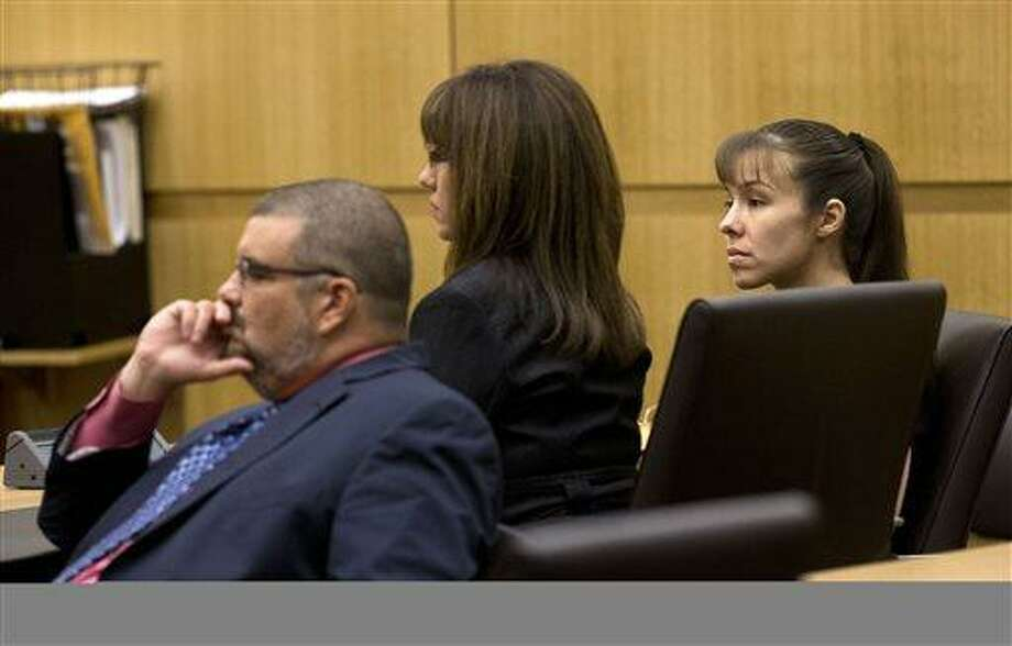Jodi Arias, right, and her defense attorneys Jennifer Wilmott and Kirk Murmi, left,  listen as Judge Sherry Stephens urges the jury to continue deliberating after the jury delivered a message that they are deadlocked on Wednesday, May 22, 2013 during the penalty phase of her murder trial at Maricopa County Superior Court in Phoenix.  Arias was convicted of first-degree murder in the stabbing and shooting to death of Travis Alexander. (AP Photo/The Arizona Republic, Rob Schumacher, Pool) Photo: AP / Pool The Arizona Republic