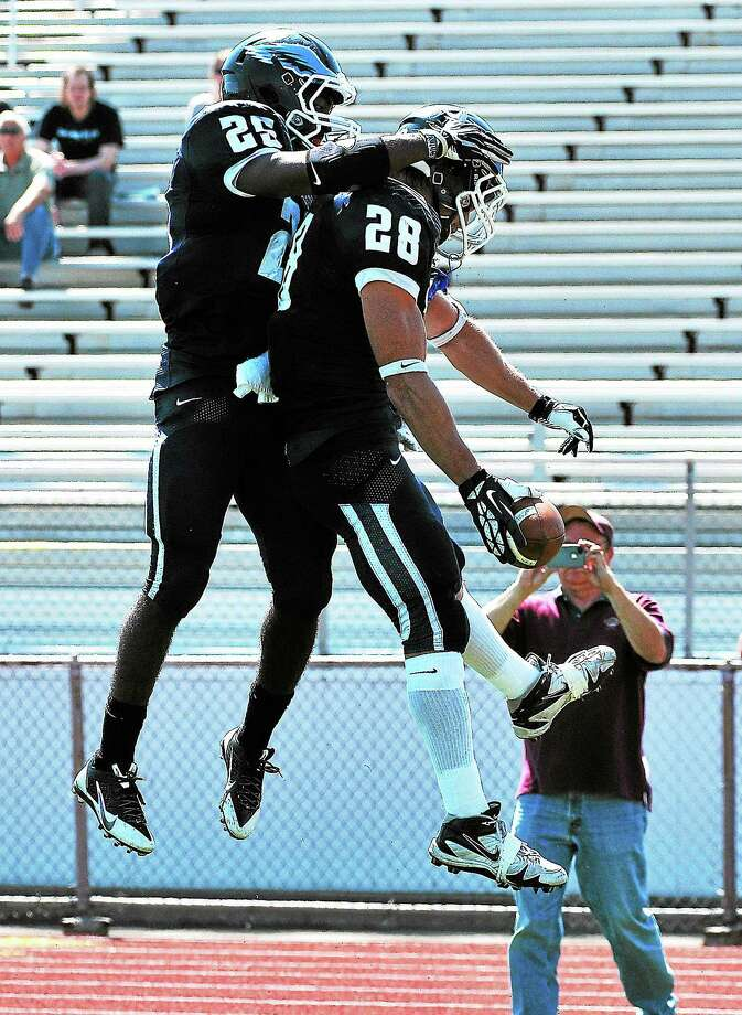 Southern Connecticut State running backs John Moscatel, right, and Vaughn Magee celebrate Moscatel's second-quarter touchdown in Saturday's loss to IUP. Photo: PETER CASOLINO — REGISTER