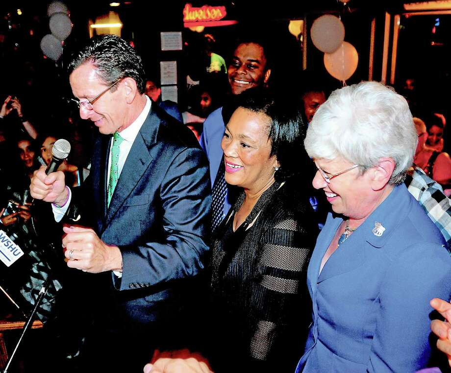 (Arnold Gold — New Haven Register)  State Senator Toni Harp (center) is sandwiched between Governor Dannel P. Malloy (left) and Lt. Governor Nancy Wyman (right) at a victory party at the Keys to the City in New Haven on 9/10/2013. Photo: Journal Register Co.