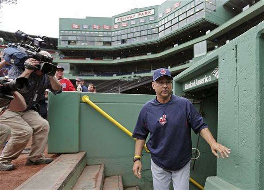 Cleveland Indians manager Terry Francona walks past photographers as he heads to the bench of the visitor's dugout before a baseball game against the Boston Red Sox at Fenway Park in Boston, Thursday, May 23, 2013. Francona was Red Sox manager for the 2004 and 2007 World Series Championship seasons. (AP Photo/Charles Krupa) Photo: AP / AP