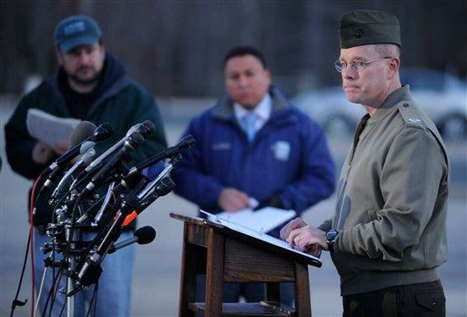 Col. David W. Maxwell holds a press conference at the Marine Corps Museum in Quantico, Va., on Friday, March 22, 2013 regarding a murder/suicide that occurred on Thursday night that resulted in the deaths of three Marines. A Marine killed a male and female colleague in a shooting at a base in northern Virginia before killing himself, officials said early Friday. (AP Photo/The Free Lance-Star, Peter Cihelka) Photo: AP / The Free Lance-Star