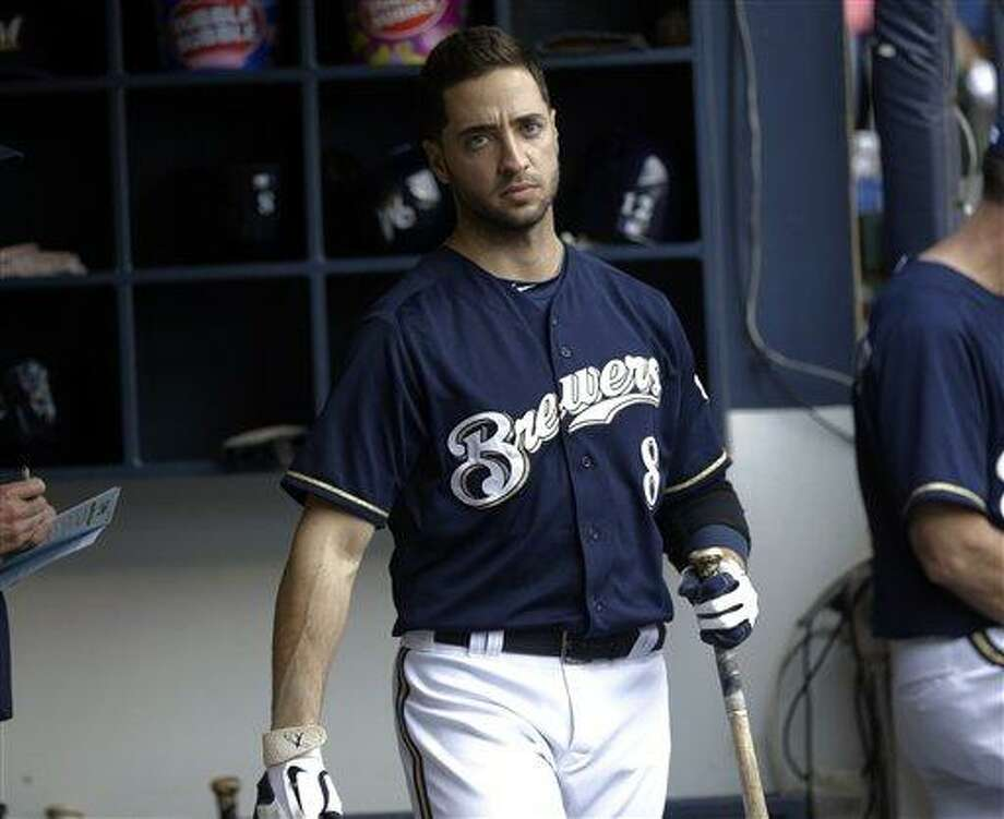 Milwaukee Brewers' Ryan Braun in the dugout during the seventh inning of a baseball game against the Cincinnati Reds Wednesday, July 10, 2013, in Milwaukee. (AP Photo/Morry Gash) Photo: AP / AP