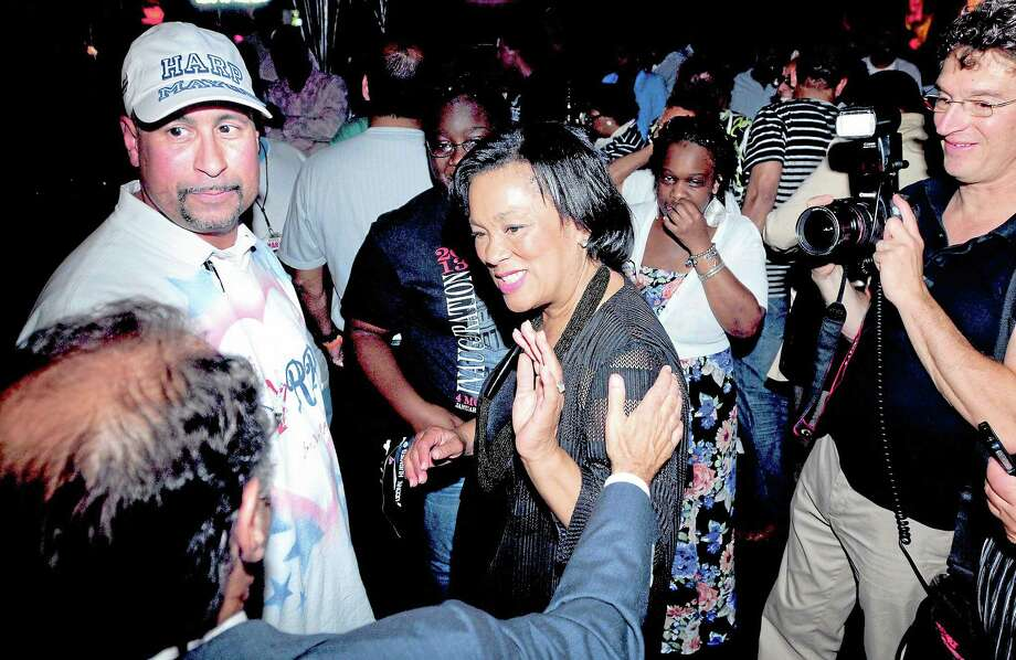 (Arnold Gold — New Haven Register)  Campaign manager Jason Bartlett (left) and State Senator Toni Harp (center) are greeted by supporters at a victory party at the Keys to the City in New Haven on 9/10/2013. Photo: Journal Register Co.