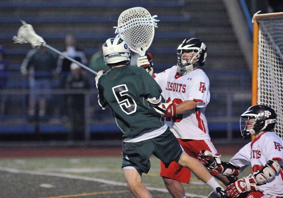 """West Haven--Guilford's Zach Cattaruzza makes the second period goal against Fairfield Prep's Connor Henry during the second quarter.  Photo-Peter Casolino/Register <a href=""""mailto:pcasolino@newhavenregister.com"""">pcasolino@newhavenregister.com</a>"""