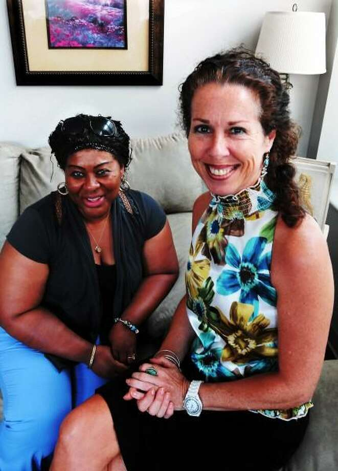 July 16, 2013. Adelaide Yalartai of New Haven is a mentor for a teenager in a program that is part of Children's Community Programs of CT. Patricia Nicolari, right, is the One-on-One Mentoring program director. The mentoring program needs more mentors. Mara Lavitt/New Haven Register