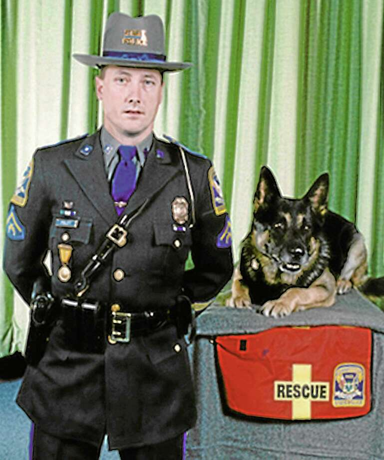 Submitted photoConnecticut State Trooper James Foley with Fidelco-bred K-9 Logan. Photo: Journal Register Co.