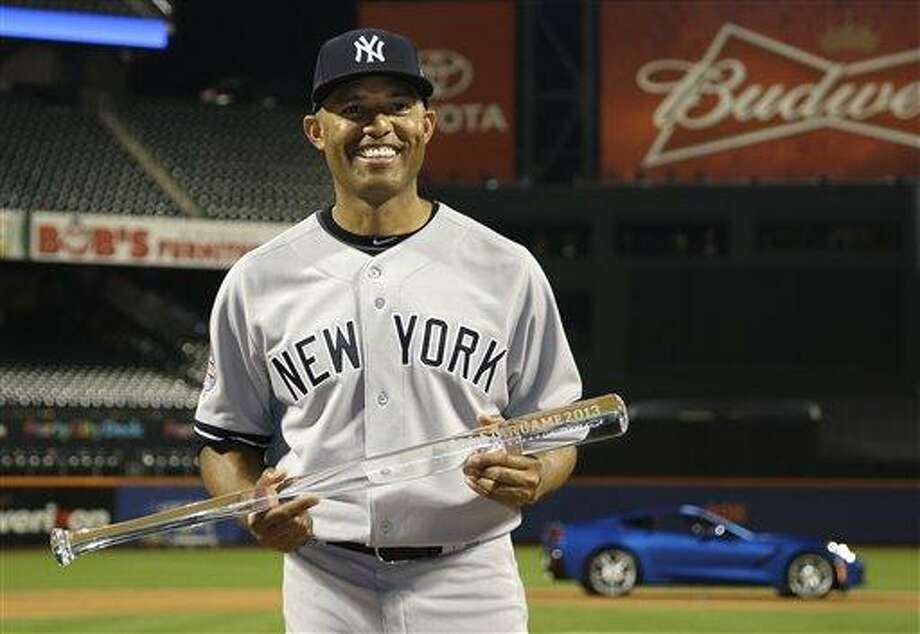 American League's Mariano Rivera, of the New York Yankees,  poses with the MVP trophy after the MLB All-Star baseball game, on Tuesday, July 16, 2013, in New York. The American League defeated the National League 3-0. (AP Photo/Matt Slocum) Photo: AP / AP