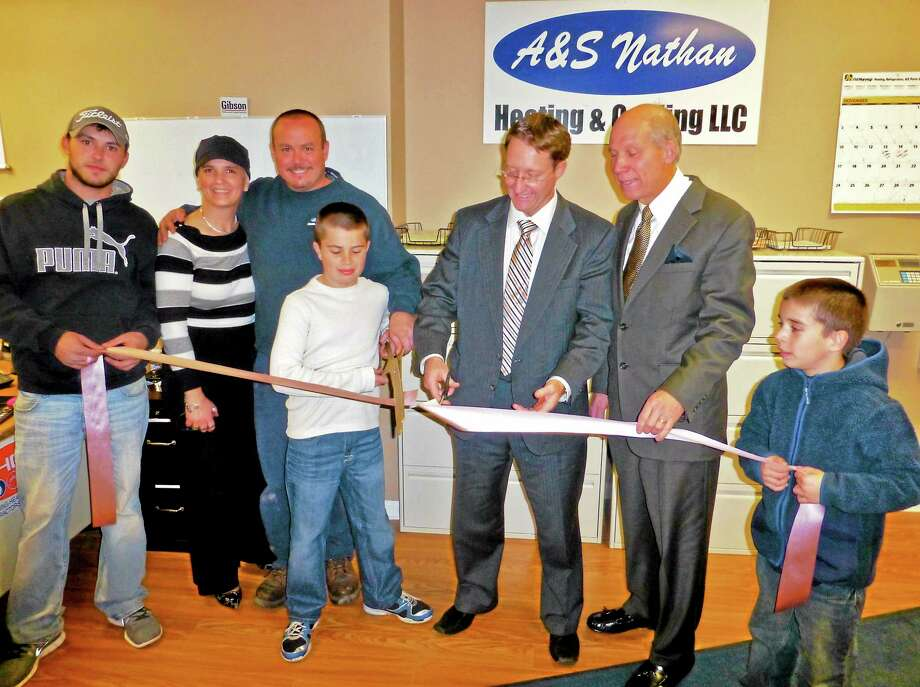Pictured from left at A&S Nathan Heating and Cooling grand opening this week are Jake Nathan, Laura Nathan, owner Allen Nathan, Michael Nathan, Ansonia Economic Development Director Peter Kelly, and Greater Valley Chamber of Commerce President William Purcell. Patricia Villers/Registe Photo: Journal Register Co.
