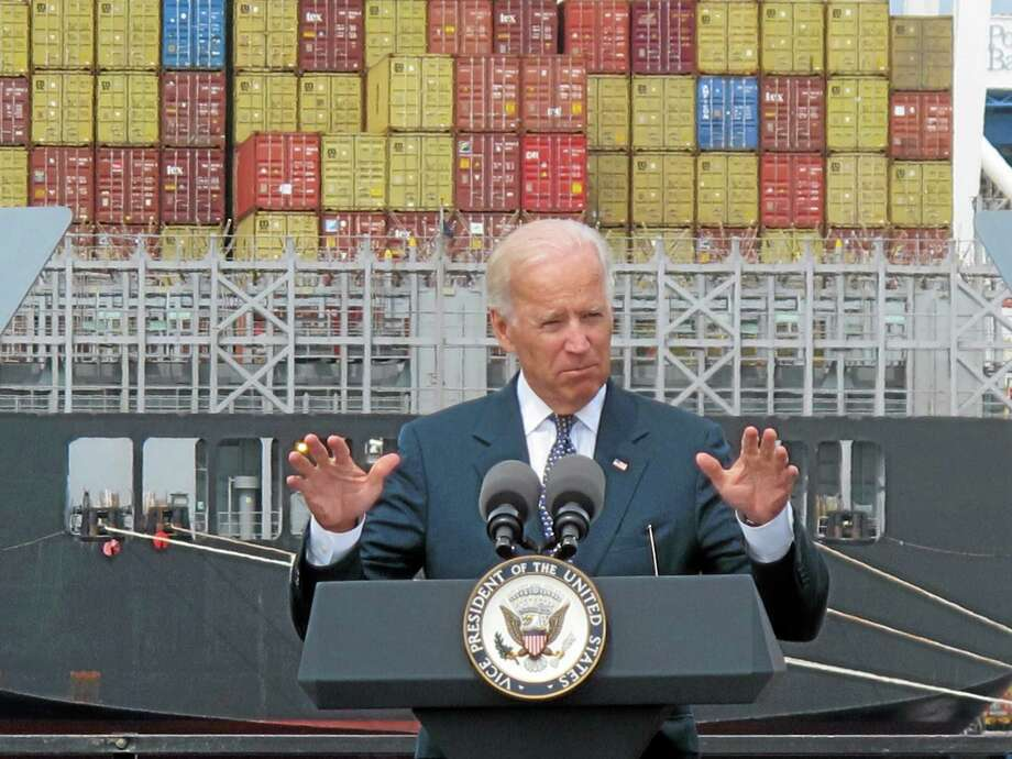 Cargo is unloaded from a vessel at the Port of Baltimore as Vice President Joe Biden speaks. Photo: Brian Witte — The Associated Press   / AP