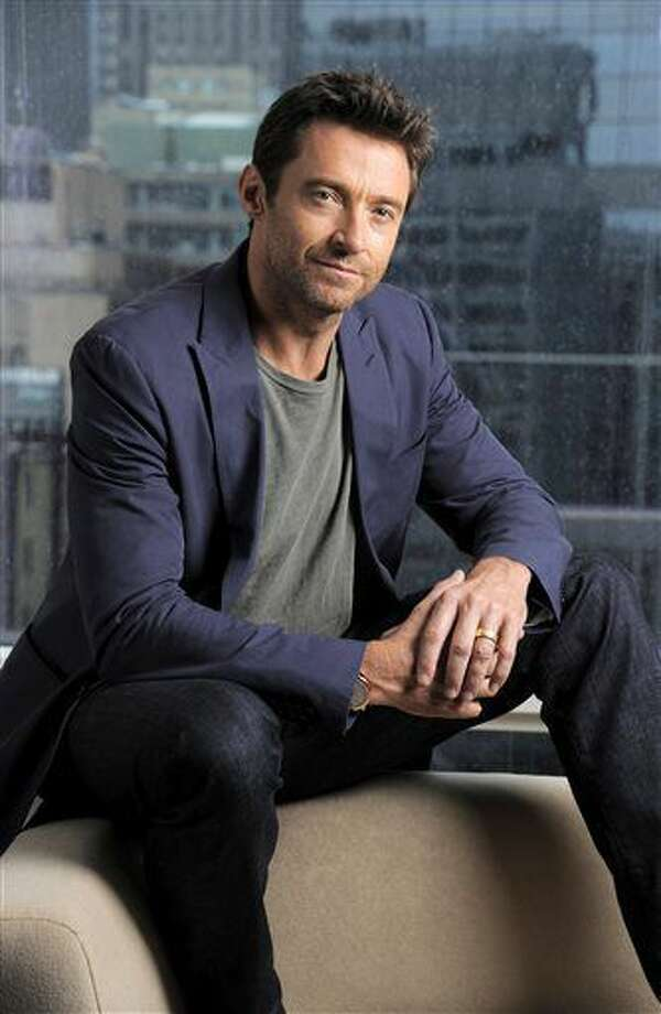 """This Sept. 7, 2013 photo shows Hugh Jackman, a cast member in the film """"Prisoners,"""" on day 3 of the 2013 Toronto International Film Festival in Toronto. (Photo by Chris Pizzello/Invision/AP) (Chris Pizzello)"""