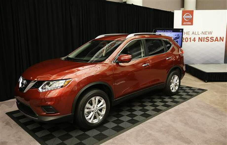 The Nissan 2014 Rogue is unveiled in Farmington Hills, Mich., Tuesday, Sept. 10, 2013. First introduced for the 2008 model year, the compact SUV offers an optional 3-row/7-passenger seating and will be built in Smyrna, Tenn. (AP Photo/Carlos Osorio) (Carlos Osorio)