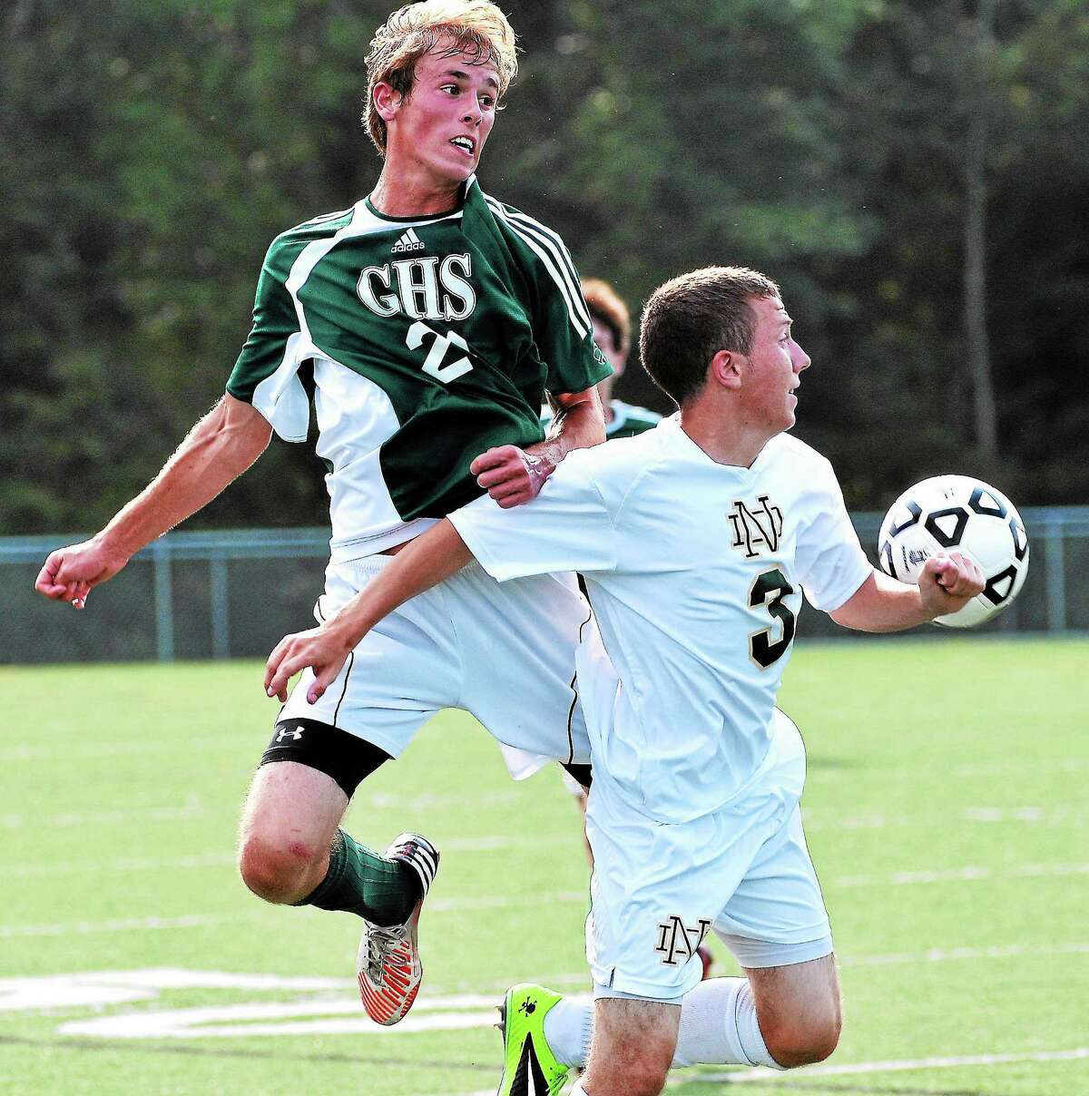 Guilford's Kyle Bianchi gets over Notre Dame-West Haven's Ryan Gannon during the first half of Guilford's 2-0 victory.