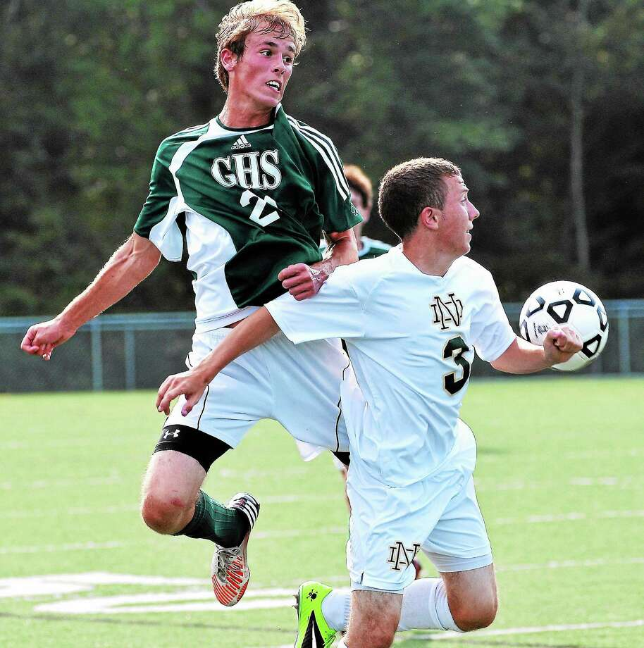 Guilford's Kyle Bianchi gets over Notre Dame-West Haven's Ryan Gannon during the first half of Guilford's 2-0 victory. Photo: Peter Casolino — The Register
