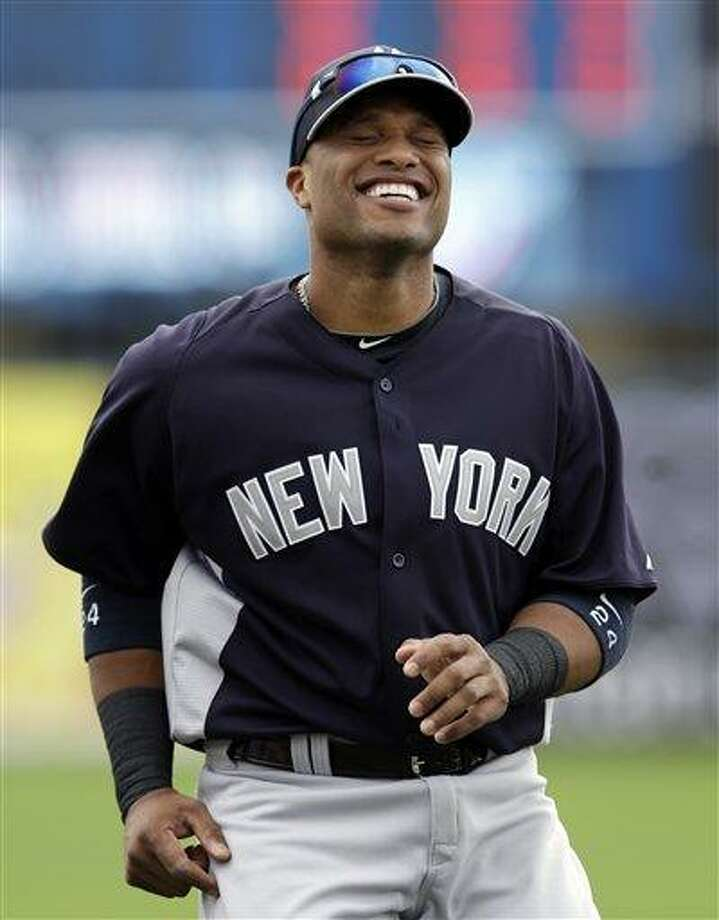 New York Yankees infielder Robinson Cano laughs prior to an exhibition spring training baseball game against the Minnesota Twins in Fort Myers, Fla., Friday, March 22, 2013. (AP Photo/Elise Amendola) Photo: ASSOCIATED PRESS / AP2013
