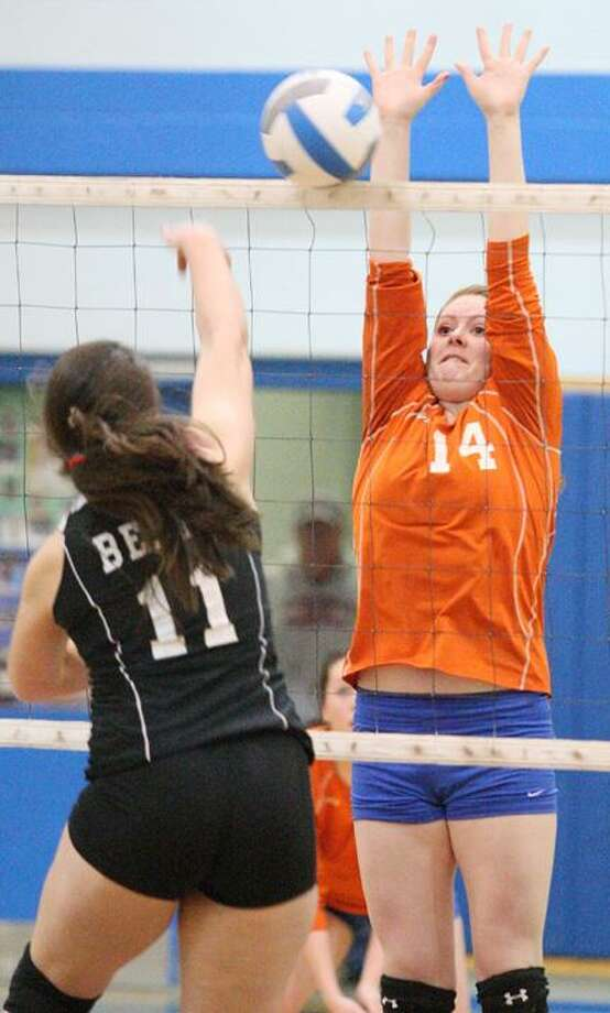 Dispatch Staff Photo by JOHN HAEGER (Twitter: @OneidaPhoto)Chittenango's Claire Charde (11) has her shot blocked by  Oneida's Katherine Clark (14) during the first game of their match on Wednesday, Jan. 23, 2013 in Oneida. Oneida won the match 3-1.