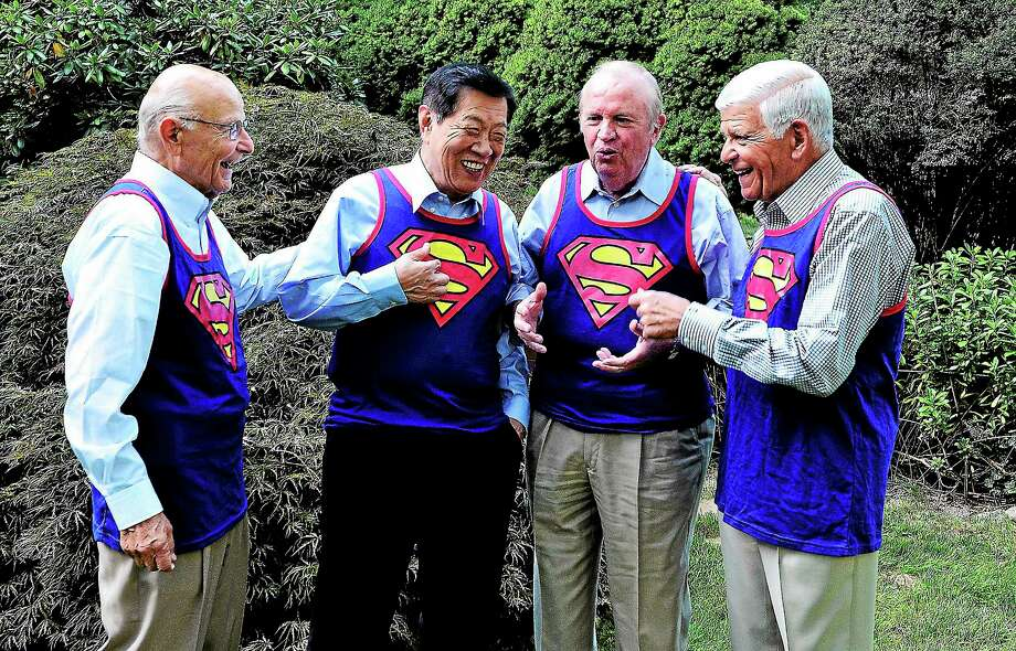 (Peter Casolino — New Haven Register)  Four local, very well known guys, Bob Alvine, left, Dr. Henry Lee, Larry DeNardis and Ron Shaw have been meeting for 15-years to celebrate their birthdays. This year, they all hit 75-years-old, the same age as Superman. DeNardis got shirts for the foursome to wear on their birthday as a gag. Photo: Journal Register Co.
