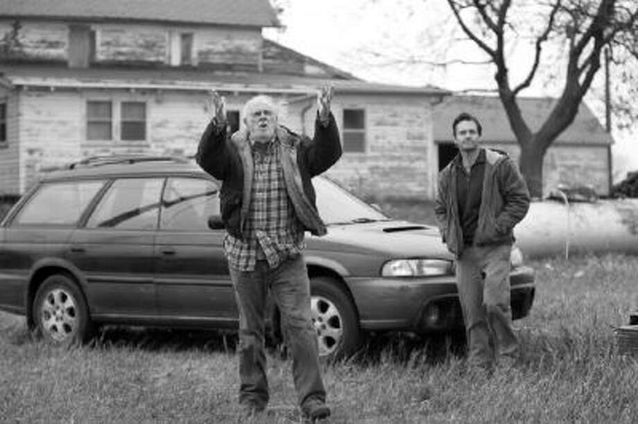 "Bruce Dern as Woody Grant and Will Forte as his son David Grant on the road to a megamillion prize in ""Nebraska."""