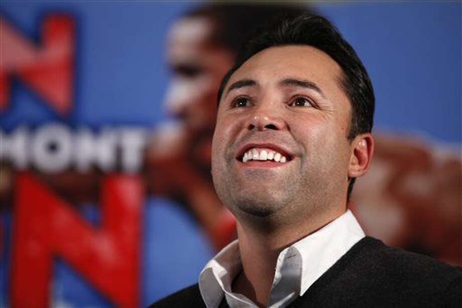 In this Dec. 9, 2011, file photo, boxing promoter Oscar De La Hoya watches during the the weigh-in for a fight between Amir Kahn and Lamont Peterson in Washington. The former boxer issued a statement Tuesday saying he voluntarily admitted himself to an unnamed facility as he continues to fight his substance abuse. Photo: The Associated Press