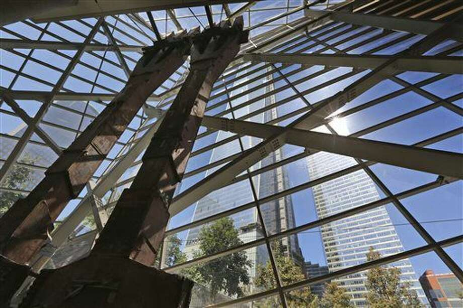 One World Trade Center, center, rises in the background behind structural steel tridents that once rose from the base of the North Tower of the World Trade Center in New York. Construction is racing ahead inside the museum during the 12th anniversary of the Sept. 11, 2001, attacks. Several more large artifacts have been installed in the cavernous space below the World Trade Center memorial plaza. (AP) Photo: Associated Press