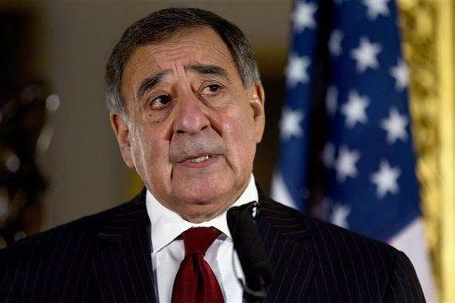 FILE - This Jan. 19, 2013 file photo shows Defense Secretary Leon Panetta speaking during a news conference in London. Panetta has removed US military ban on women in combat, opening thousands of front line positions. (AP Photo/Jacquelyn Martin, File) Photo: AP / AP