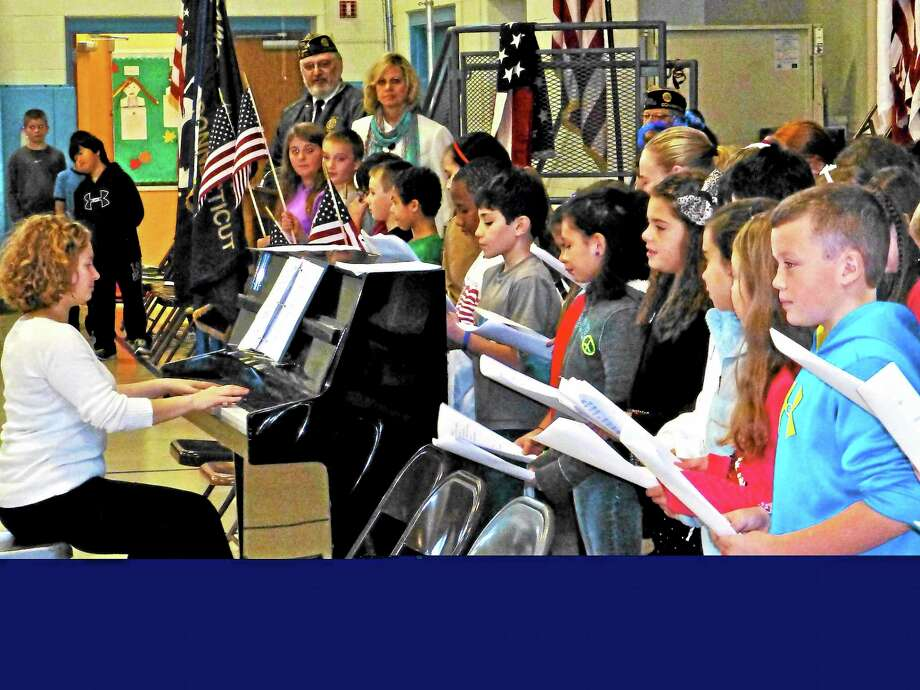 Bungay School students sing patriotic songs Wednesday during a Veterans Day program in Seymour. Photo: Patricia Villers — New Haven Register