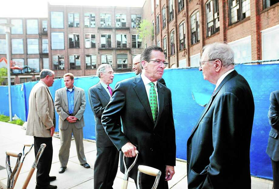 (Arnold Gold — New Haven Register)  Governor Dannel Malloy (center) speaks with Albert Ratner (right), co-chairman emeritus of Forest City, during a groundbreaking ceremony in the courtyard of what will be Winchester Lofts at Science Park in New Haven on 9/10/2013. Photo: Journal Register Co.