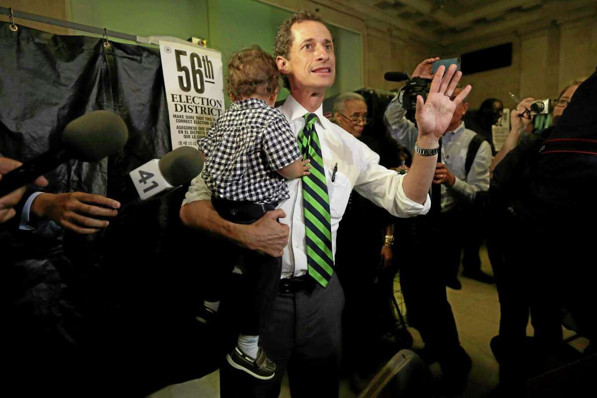 Democratic mayoral hopeful Anthony Weiner holds his son Jordan as he speaks to reporters after casting his vote at his polling station during the primary election in New York, Tuesday, Sept. 10, 2013. (AP Photo/Mary Altaffer)
