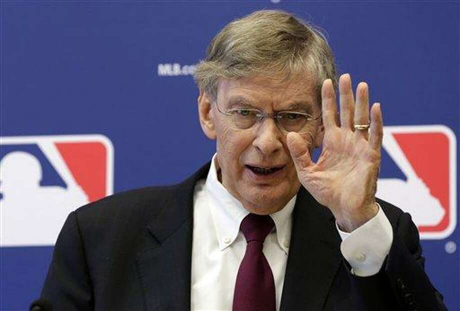 Commissioner Bud Selig answers a question during a news conference at Major League Baseball headquarters, in New York, Thursday, May 16, 2013. (AP Photo/Richard Drew) Photo: AP / AP